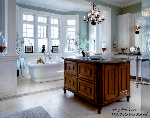 A touch of Greenery in wall color beautifully accents the core neutrals in this Peter Salerno Inc. bath design.