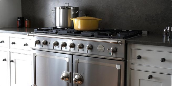 The CornuFé 110, with its powerful five-burner cooktop, in stainless steel.