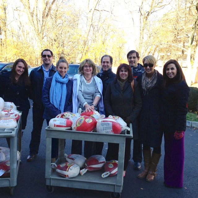 Peter Salerno's staff delivering Thanksgiving turkeys to St. Andrew's Church.