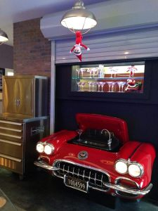 Elliot the Elf can't resist our 1959 Corvette - transformed into an amazing bar!