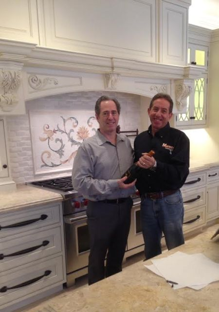 Peter Salerno stands in front of a gorgeous custom backsplash.