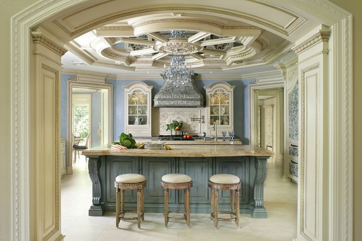 An ornate RangeCraft reclaimed tin range hood is the centerpiece of this award-winning kitchen design.