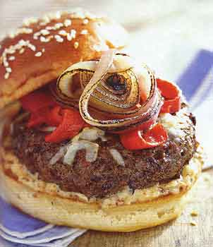 Memorial Day burger recipe. Beef and andouille sausage burger with asiago cheese recipe. Photo by Mark Thomas, courtesy of Epicurious.