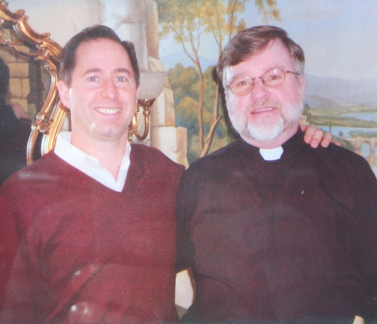 Peter Salerno (left) with Father Jim Kelly.