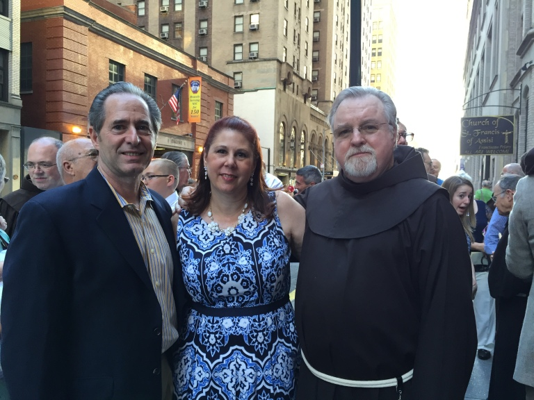 Peter and Tracy Salerno (left) with Father Jim Kelly.