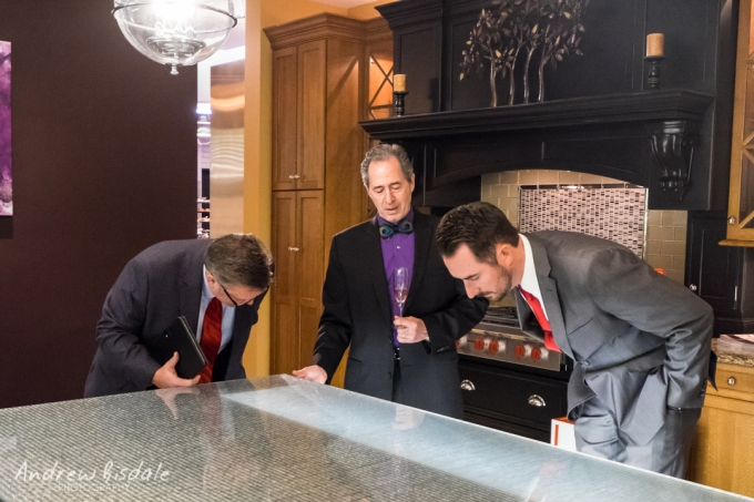 Peter Salerno (center) and Miele USA representatives admiring the custom kitchen island.