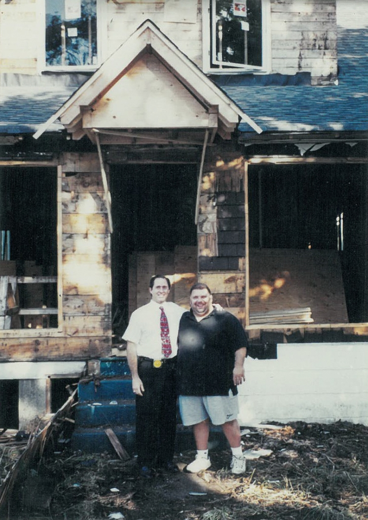 Peter Salerno with his friend Frankie in front of the renovations to his first showroom.