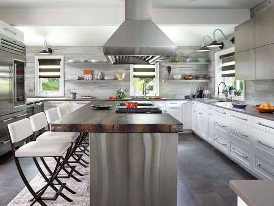 Custom range hoods can feature well in beautiful transitional kitchen designs, like this one from Peter Salerno Inc.