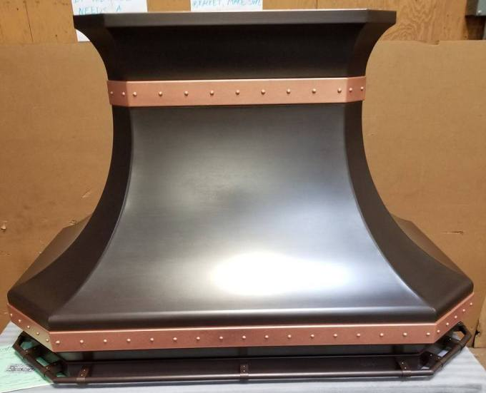 A closer look at a custom RangeCraft range hood design.