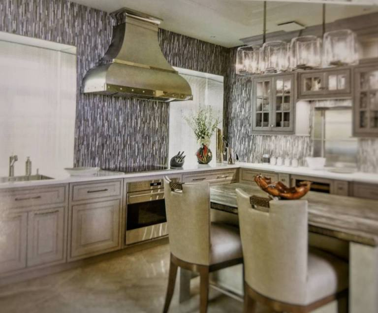 A custom RangeCraft range hood dazzles in this Moscow kitchen design by Peter Salerno Inc.